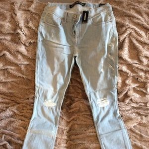Express midrise jeans lt blue holes in knees. NWT
